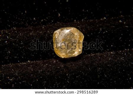 yellow diamond, precious gemstone uncut - stock photo