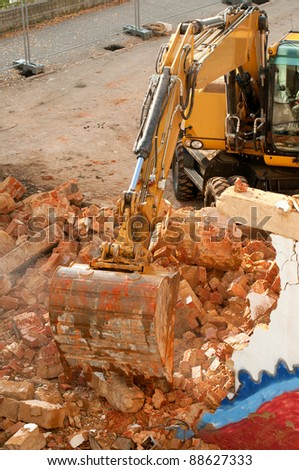Yellow Digger in House Under Demolition - stock photo