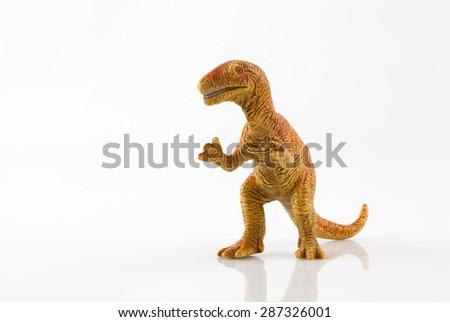 Yellow dinosaur toy isolated on white - stock photo