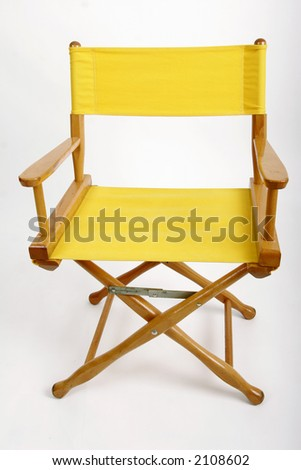 Yellow director's chair against a white background - stock photo