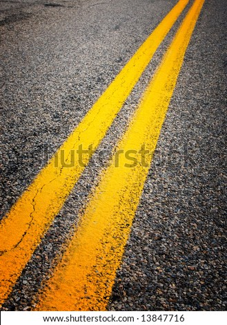 yellow dividing lines on the highway - stock photo