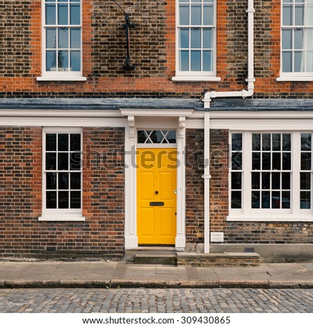 Yellow door in London. Filtered image.