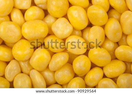 Yellow dragee, sugar covered nuts, background