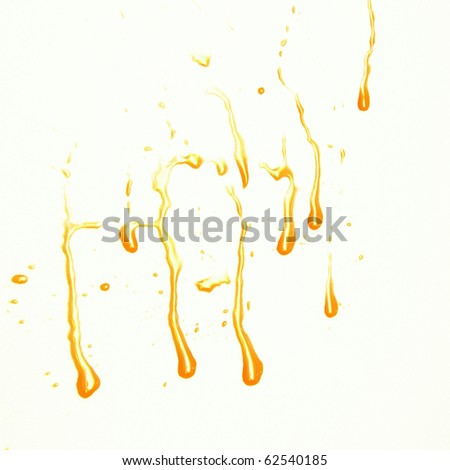 yellow  drips and drops isolated on  white - stock photo