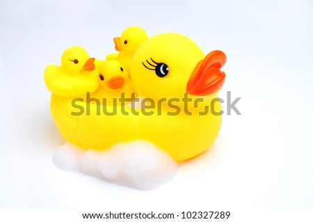 yellow duck with baby - stock photo