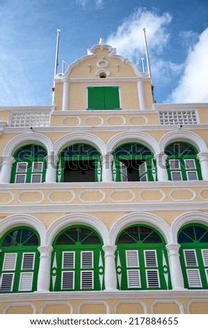 Yellow Dutch colonial architecture in Willemstad, Curacao, Netherland Antilles. - stock photo