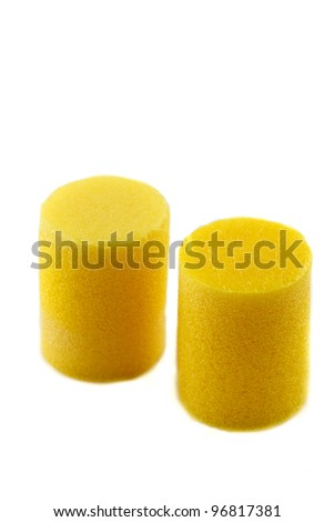 yellow ear plugs on a white background - stock photo