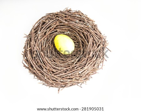 Yellow egg in the nest, isolated on white, top view - stock photo