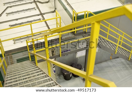 yellow emergancy exit staircase in a factory - stock photo