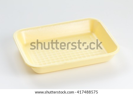 Yellow empty food tray on white background - stock photo
