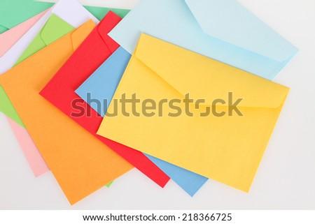 Yellow envelope on the colorful envelopes - stock photo