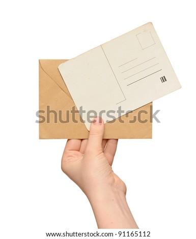 yellow envelope with vintage blank card in the hand isolated on white background - stock photo