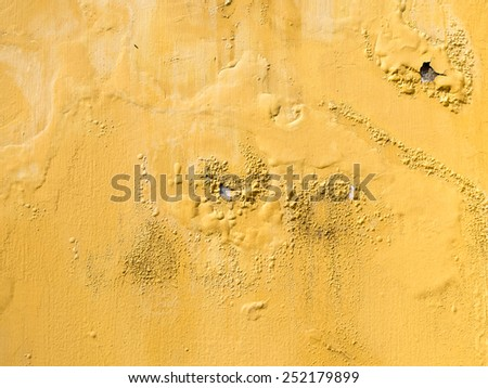 yellow erode painted concrete wall,grunge rough texture background - stock photo