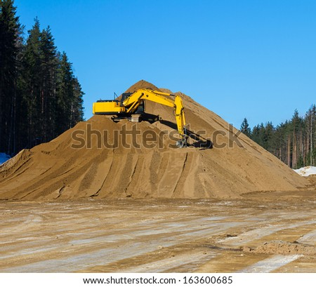 Yellow excavator at work  - stock photo