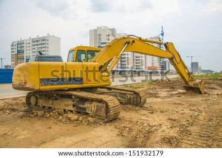 Yellow excavator or Bulldozers in town Copy space for inscription - stock photo