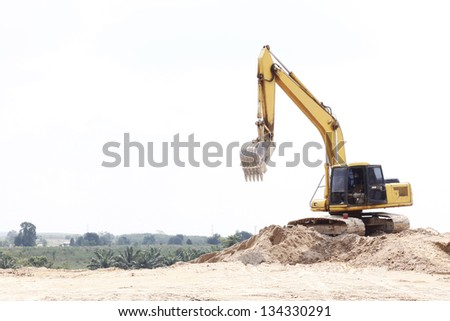 Yellow Excavator park on sand pile at Construction Site