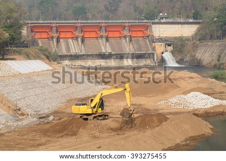 Yellow Excavator work  at Construction Site