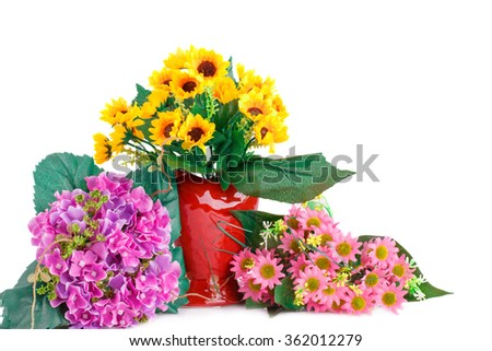 Yellow fabric flowers in vase and pink flowers isolated on white background. - stock photo