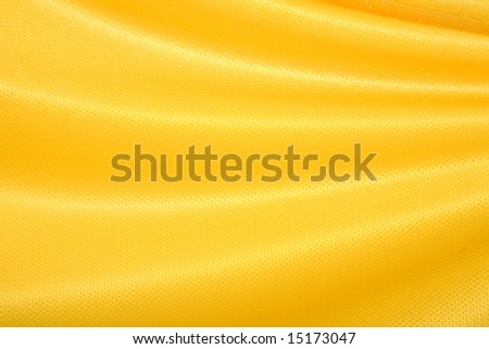 yellow fabric made from jersey material waving gently good for background uses