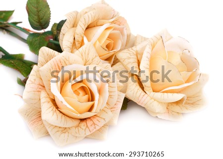Yellow fabric roses on white background. - stock photo