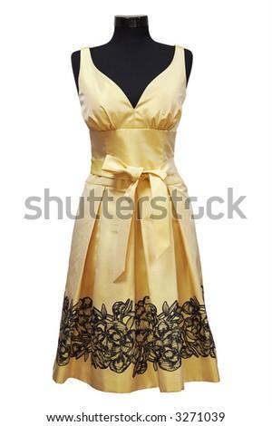 Yellow female dress on a white background - stock photo