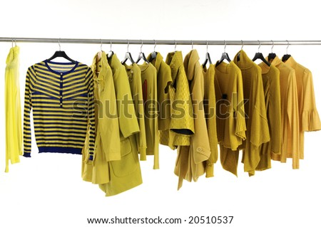 Yellow female jacket on hangers at the show - stock photo