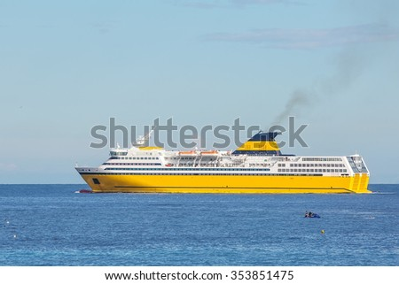 Yellow ferry ship on her voyage in Mediterranean, in front of Nice, on the Azzure Coast  - stock photo