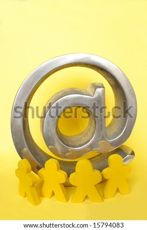 Yellow figures with arroba symbol in color background - stock photo