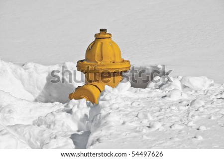 Yellow Fire Hydrant buried in snow in Manassas, Virginia - stock photo