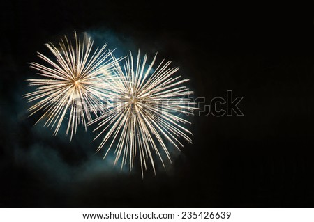Yellow fireworks with copy space - stock photo