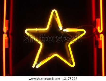 yellow five-poin star and orange lines - stock photo