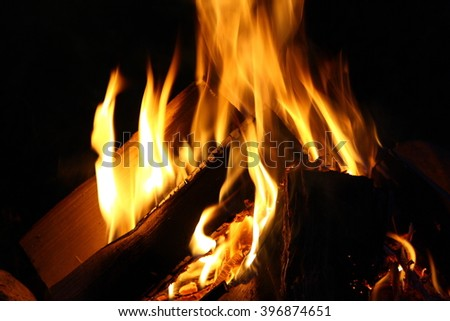 Yellow flame of a bonfire