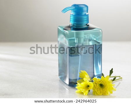 yellow flower in front of the toner dispencer - stock photo