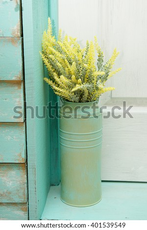 yellow flowers and blue wooden background from boards