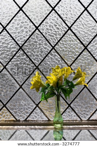 Yellow flowers bouquet at vitrage window - stock photo
