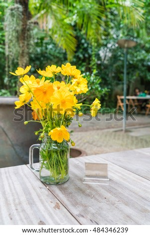 yellow flowers decoration on dinning table