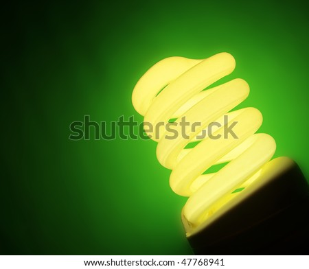 Yellow fluorescent lamp on green background - stock photo