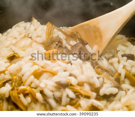 Yellow Foot Mushroom Risotto Steaming in a Kettle with a Spoon - stock photo