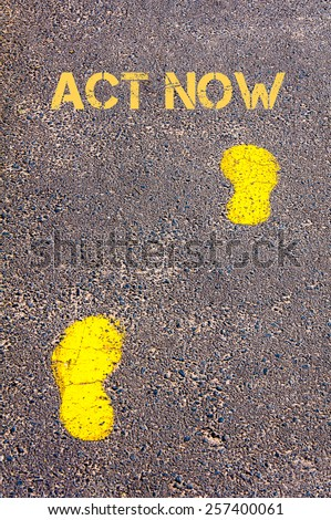 Yellow footsteps on sidewalk towards Act Now message.Conceptual image
