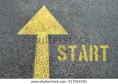 Yellow forward road sign with Start word on the asphalt road. Business concept.