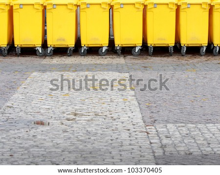 yellow garbage bins - stock photo