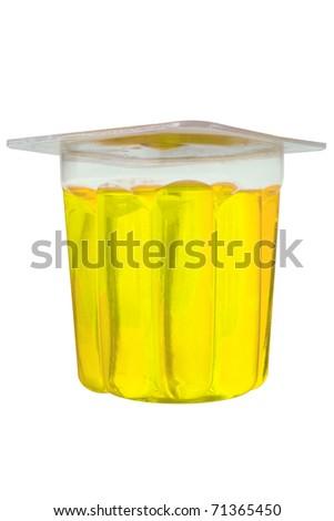 yellow gelatin glass on a white background - stock photo