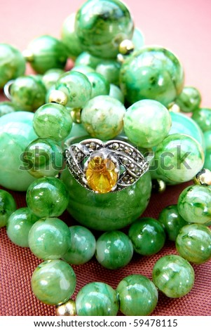 Yellow Gemstone Ring with Green Beads - stock photo