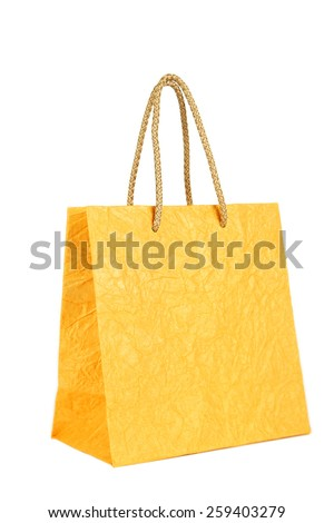 Yellow gift bag isolated on white - stock photo