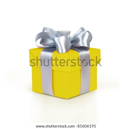yellow gift box with silver ribbon and bow isolated on white - stock photo