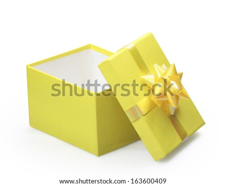 yellow gift box with yellow ribbon  - stock photo