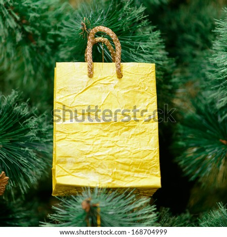 yellow gift package decorations on Christmas tree. new year - stock photo