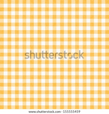 Yellow gingham tablecloth background or texture - stock photo