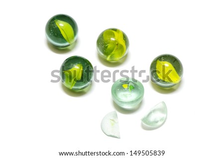 yellow glass marble balls and broken isolated on white background - stock photo