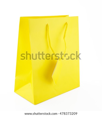 Yellow glossy gift bag on white background